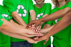 Group of environmental activists putting hands together Stock Photos