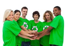 Environmental activists putting their hands together Stock Photos