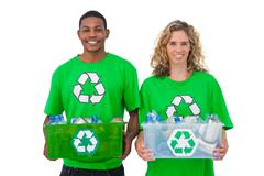 Two  cheerful environmental activists holding box of recyclables Stock Photos