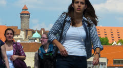 T/L Skyline Nuremberg old town castle hill passersby in Konig street Stock Footage