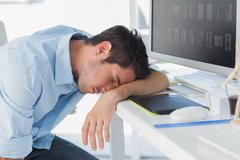 Stock Photo of Graphic designer sleeping on the keyboard