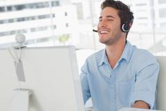 Happy designer laughing during an online communication - stock photo