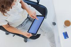 Overview of a designer using her tablet pc - stock photo