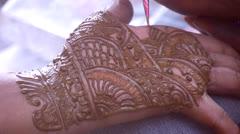 Henna dye Body art Stock Footage