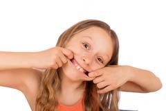 Happy girl make a grimace Stock Photos