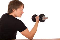 man make exercise with dumbbell - stock photo