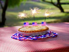 4th of July Apple Pie with Sparklers on a Table Stock Photos