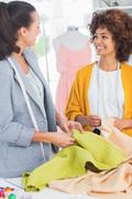Fashion designers touching textile Stock Photos