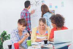 Designers having a brainstorm together - stock photo