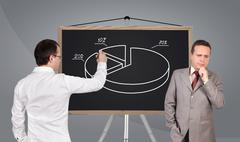 businessman drawing pie chart - stock photo