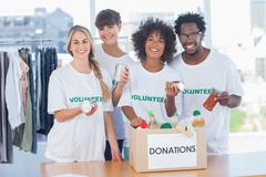 Stock Photo of Volunteers taking out food from a donation box