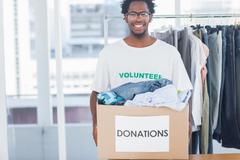 Stock Photo of Attractive man holding a donation box