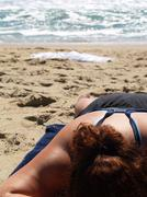 Woman tanning on the beach Stock Photos