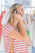 Blonde woman in a clothing store Stock Photos