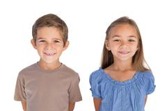 Stock Photo of Two children standing and smiling at camera