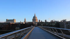 Millennium Bridge and St Pauls Cathedral at early morning. London, UK Stock Footage