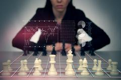 Playing Chess Against a Business Woman with Floating Financial Graphics Stock Illustration