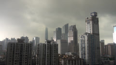 Fast motion of Aerial view of Guangzhou during storm,blurred logos, China Stock Footage