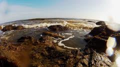 Wide Angle Foamy Ocean Surf Splashing Against Rocky Shore Stock Footage
