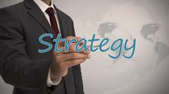 Businessman writing strategy Stock Photos