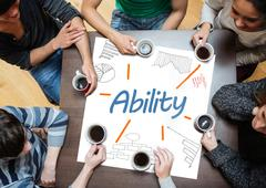 Stock Photo of Ability written on a poster with drawings of charts