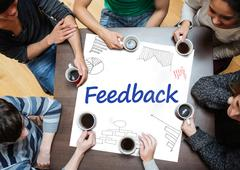 Stock Photo of Feedback written on a poster with drawings of charts