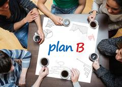 Plan b written on a poster with drawings of charts - stock photo