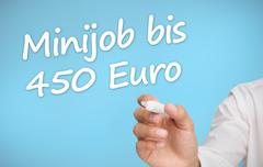 Stock Photo of Businessman writing with a marker minijob bis 450 euro