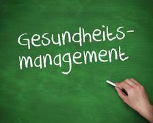 Hand writing gesundheits management Stock Photos