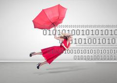 Stock Photo of Woman flying with a broken umbrella