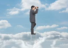 Businessman on ladder over the clouds Stock Photos