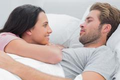 Stock Photo of Couple awaking and looking at each other