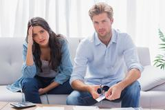 Couple looking anxious while doing their accounts - stock photo