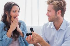 Man asking his partner to marry him - stock photo