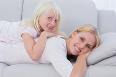 Stock Photo of Mother and daughter lying on couch