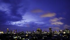 Panorama view of city skyline at night Stock Photos