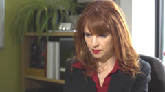Pretty Redhead in Office Stock Footage