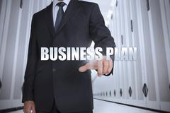Businessman selecting the term business plan - stock photo