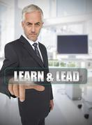 Businessman touching the term learn and lead - stock photo