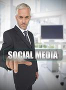 Businessman touching the term social media Stock Photos