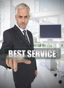 Stock Photo of Businessman touching the term best service