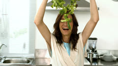 Woman lets fall lettuce while preparing a salad Stock Footage
