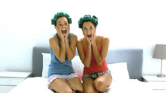 Friends with hair roller laughing together Stock Footage