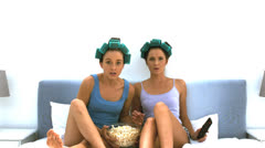 Friends watching TV and throwing pop corn Stock Footage