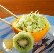 fruit salad oranges studded - stock photo