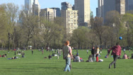 People playing football soccer Central Park Manhattan New York City USA Stock Footage