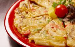 Japanese food close-up okonomiyaki. Stock Photos