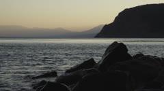 Black sea coast with rocks at sunset. Wide shot filmed at 24 fps Stock Footage