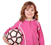 beautiful little girl with soccer ball - stock photo