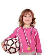 little girl with gold medal and soccer ball - stock photo